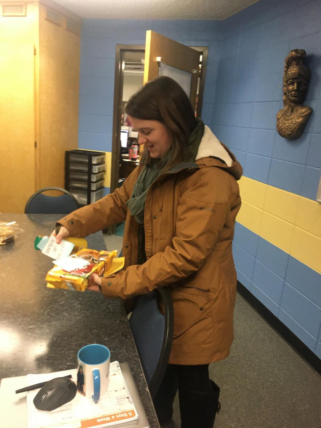 Ms. Kelly Stephens checks out a gift presented to her by the Greeley West Student Council last week for National Counselors Week.