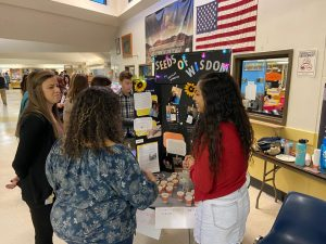 Sophomore Whitley Mireles shares her personal project on Monday night in the Greeley West commons.
