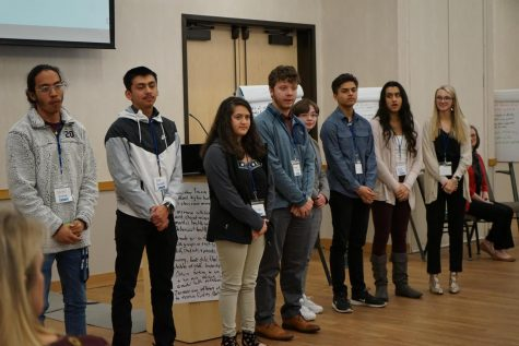 Students from around Greeley present to a room setting goals for District 6 in the next ten years.  Sophomore Emma Rodas, junior Anuj Panta, and senior Grace Chahal took part in the group.