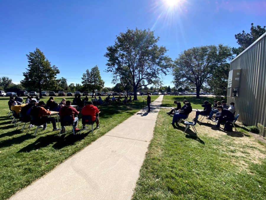 Social studies teacher Mr. Ky Dietz holds a mock trial outside on Tuesday, soaking up the sun.