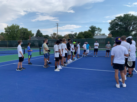 The boys tennis team lines up against cross-town rivals Greeley Central earlier this season.