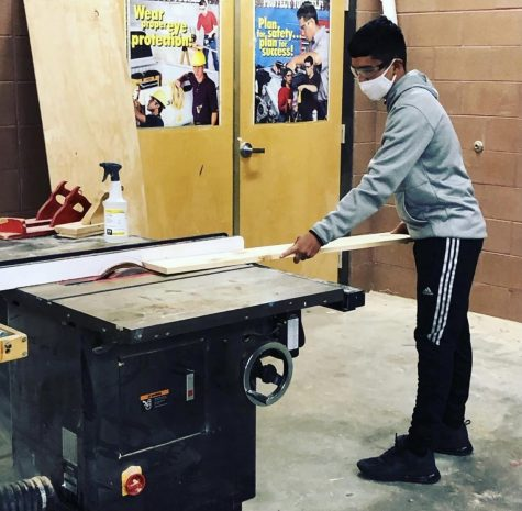 "Working in the wood shop has presented challenges in this era of ""no hands.""  But students are finding ways to make the most of their eight week quarter class."