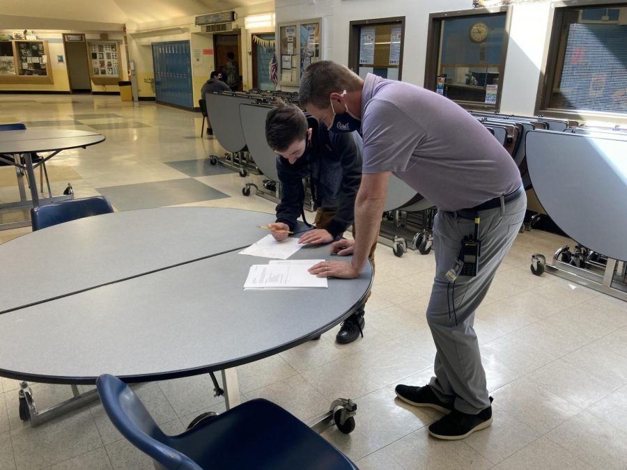 Greeley West principal Mr. Jeff Cranson helps freshman Wyatt Moon in the commons with some math homework on Monday.