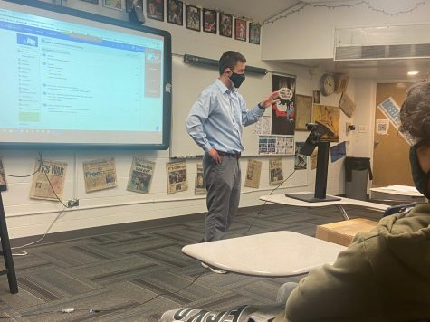 Social studies teacher Mr. Don Wagner teaches in-person and virtually in front of his camera and Zoom screen.  Next week, Wagner gets to pack up the camera when all students return to in-person learning.