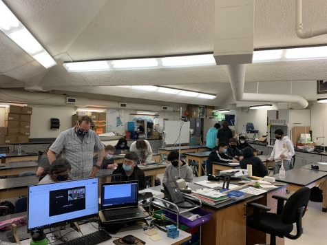 Mr. Zach Armstrong works with freshmen during his Physics class on Monday.  It was the first time that all students in his class were able to collaborate with one another since before Spring Break of 2020.