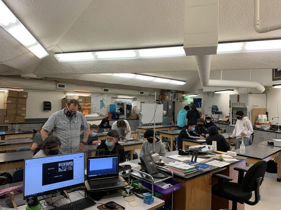Mr.+Zach+Armstrong+works+with+freshmen+during+his+Physics+class+on+Monday.++It+was+the+first+time+that+all+students+in+his+class+were+able+to+collaborate+with+one+another+since+before+Spring+Break+of+2020.