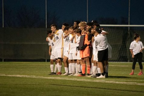 Goalkeeper Tommy Roth celebrates winning the MVP award with his team after West beat Central 1-0 on Monday night.