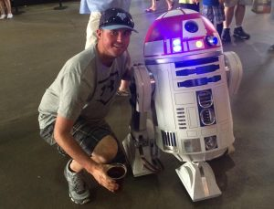 Mr. Jeff Cranson poses for a picture with R2D2.