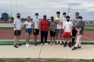 The Greeley West distance team poses for a picture with Thomas Valles.  Valles was a state-champion cross country runner who was the inspiration for the Disney movie McFarland, USA.