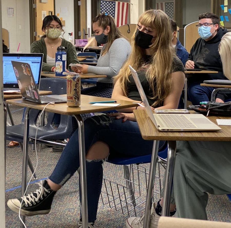 Greeley West senior Kayla Becker listens to her teacher during IB History 2 on Tuesday. Becker was recently accepted to Cornell University.