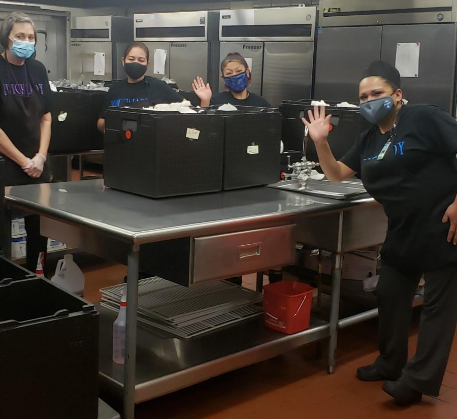 The Greeley West lunch ladies take a break to pose for a picture on Friday morning.