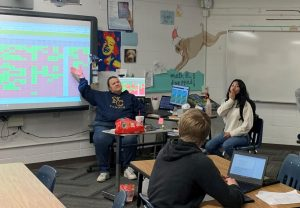 Ms. Jane Burke reminds her students one last time how they need to get work in for their classes this week.  Burke's last day at Greeley West is Friday.
