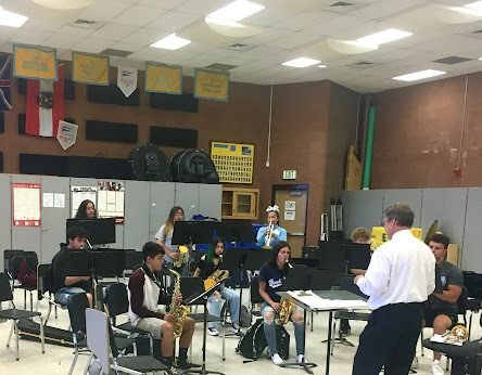 Band director, Mr. Chet Arthur, guides the GWHS band in a socially distant rehearsal space. Arts students continue to be impacted by COVID-19 protocols.