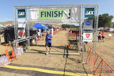 Mr. Tom Nugent triumphantly runs through the finish line at the Fall Equinox Marathon.