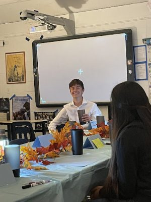 Greeley West senior Dylan Gesick plays the part of James Monroe during last weeks Symposium on the Common Good in AP U.S. History Class.